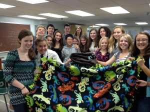 Concord Academy Students in Action (CASA) members with fleece blankets for homeless mothers and children.
