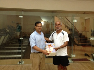"Satinder Bajwa, Founder & Trustee of Khelshala presenting a ""thank you"" gift to Khelshala Secretary."