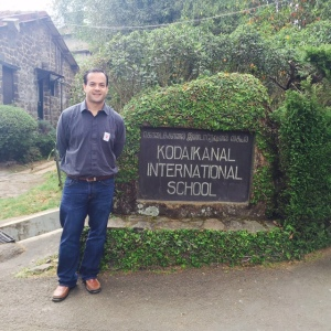 Near the Main Gate at Kodaikanal International School visit in 2016.