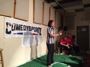 Courtney Pong, the Referee (GM and Owner) of Comedy Sportz,Boston leading the show.